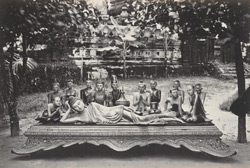 Carved figures, Rangoon. A reclining 'Gaudama', with attendant worshippers.